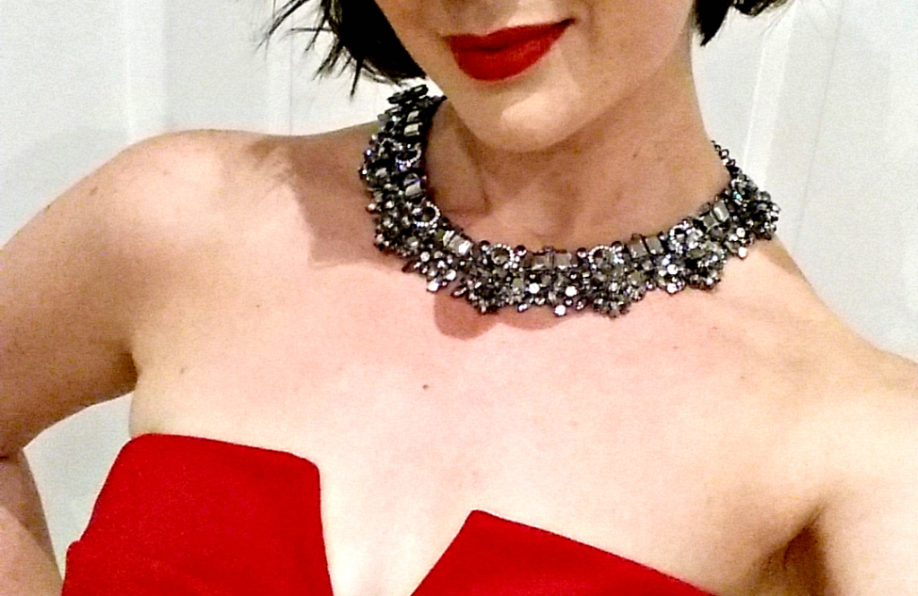 a little red dress and corker of a statement necklace