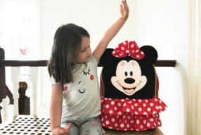A 'MINNIE' SUITCASE FOR ELSIE